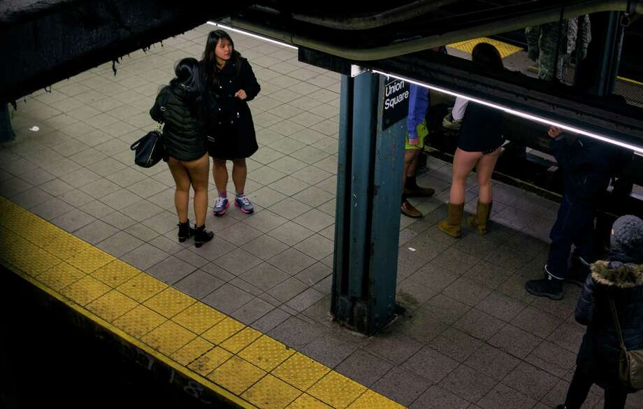 People not wearing pants stand on a subway platform at 14th Street Union Square subway station as they take part in the annual No Pants Subway Ride Sunday, Jan. 12, 2014, in New York. The staged event, organized by the group Improv Everywhere, invited people onto the subways without pants to act out what might be a normal commute. Photo: Craig Ruttle, AP / FR61802 AP