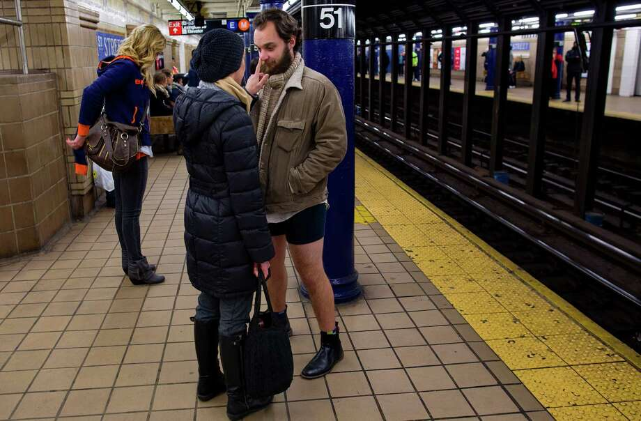 Annette Tobiasz, of Highlands, N.J., touches the nose of Timothy Lowe, also of Highland, N.J. as he participates on a subway platform in the annual No Pants Subway Ride, Sunday, Jan. 12, 2014, in New York. The staged event, organized by the group Improv Everywhere, invited people onto the subways without pants to act out what might be a normal commute. Photo: Craig Ruttle, AP / FR61802 AP