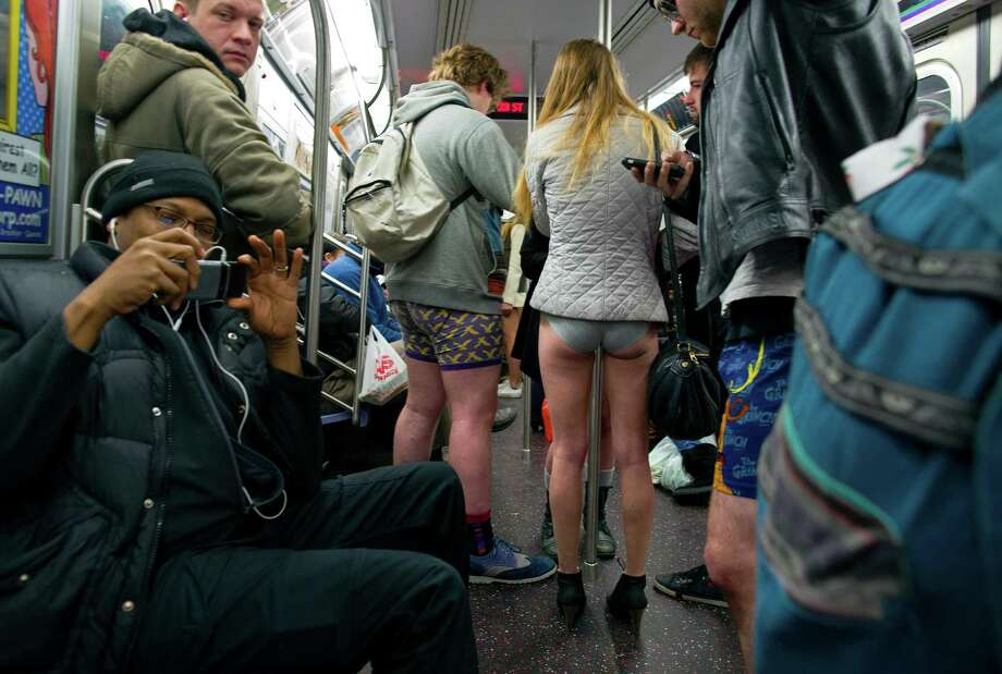 Participants not wearing pants ride a subway train while taking part in the annual No Pants Subway Ride Sunday, Jan. 12, 2014, in New York. The staged event, organized by the group Impro Everywhere, invited people onto the subways without pants to act out what might be a normal commute. Photo: Craig Ruttle, AP / FR61802 AP