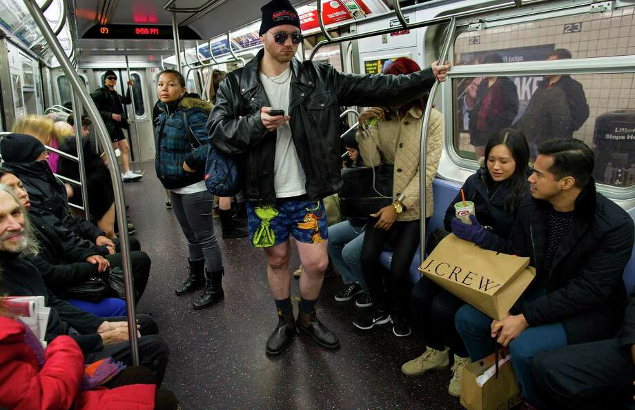 A participant not wearing pants stands on a subway train while taking part in the annual No Pants Subway Ride, Sunday, Jan. 12, 2014, in New York.The staged event, organized by the group Improv Everywhere, invited people onto the subways without pants to act out what might be a normal commute. Photo: Craig Ruttle, AP / FR61802 AP
