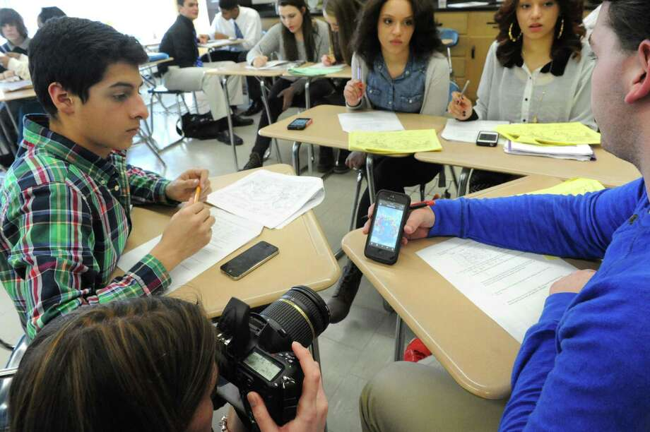Students in teacher Jessica Sanderson's earth science class use a smart phone app called, Quake Feed, to do research on Thursday Dec. 19, 2013 in Latham, N.Y. (Michael P. Farrell/Times Union) Photo: Michael P. Farrell / 10025104A