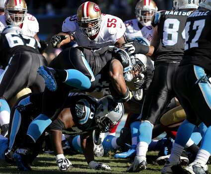 Mike Tolbert (35) can't score a touchdown for the Panthers in the first half Sunday January 12, 2014. The San Francisco 49ers beat the Carolina Panthers 23-10 in Charlotte, North Carolina to advance to the NFC title game against Seattle. Photo: Brant Ward, The Chronicle