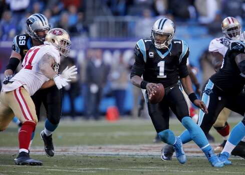 Cam Newton (1) of the Panthers looked over at Dan Skuta (51) who was about to sack him in the second half Sunday January 12, 2014. The San Francisco 49ers beat the Carolina Panthers 23-10 in Charlotte, North Carolina to advance to the NFC title game against Seattle. Photo: Brant Ward, The Chronicle