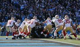 The 49er defense holds the Panthers on a fourth down goal line stance during the second quarter as the San Francisco 49ers went on to beat the Carolina Panthers 23-10, in the NFC divisional playoffs in Charlotte, North Carolina on Sunday Jan. 12, 2014, at Bank of America stadium.