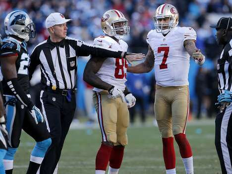 Colin Kaepernick (7) and Vernon Davis (85) were corralled by referee Carl Cheffers after a pushing incident in the second half Sunday January 12, 2014. The San Francisco 49ers beat the Carolina Panthers 23-10 in Charlotte, North Carolina to advance to the NFC title game against Seattle. Photo: Brant Ward, The Chronicle