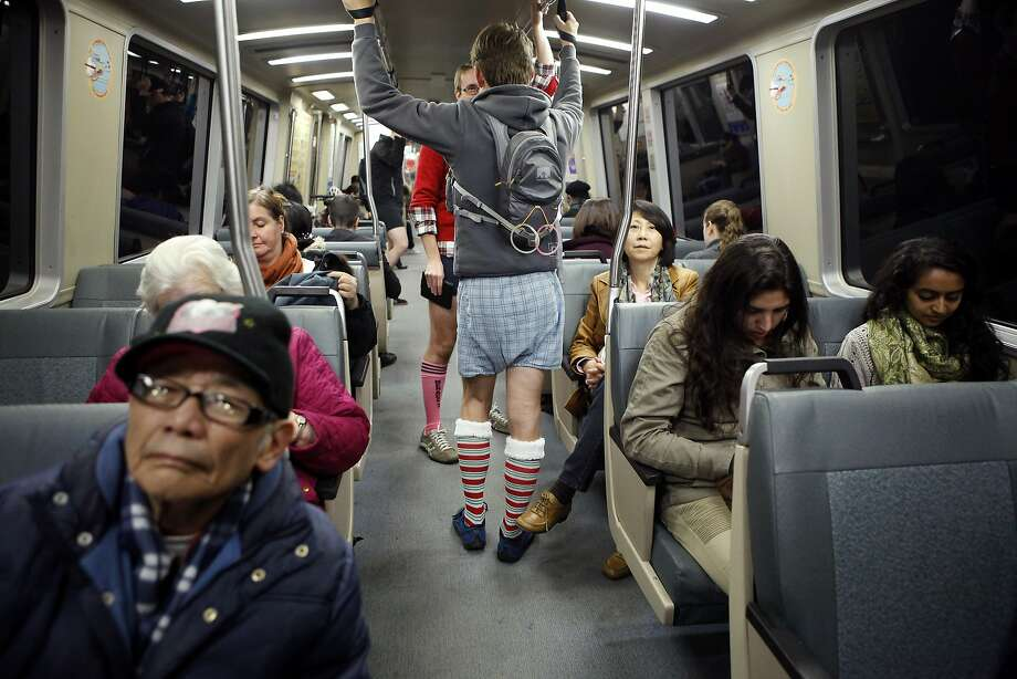 Participants of the annual No-Pants Subway Ride are seen on a train heading downtown from the Balboa BART station in San Francisco, CA, Sunday, January 12, 2014. Photo: Michael Short, The Chronicle