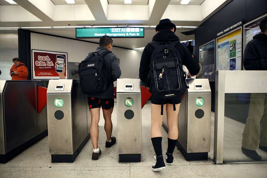 Participants of the annual No-Pants Subway Ride exit through the turnstiles at the Montgomery BART station in San Francisco, CA, Sunday, January 12, 2014. Photo: Michael Short, The Chronicle