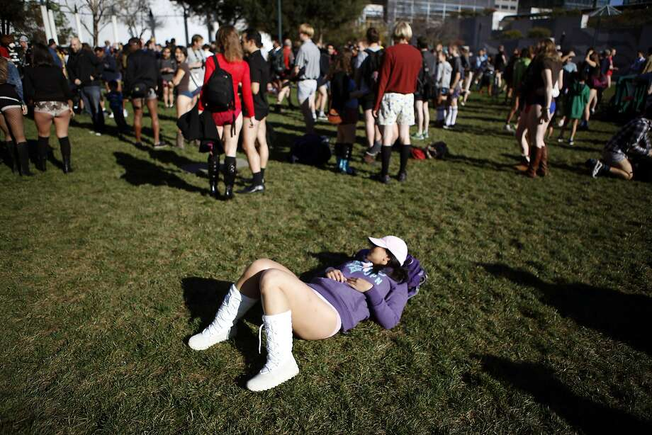 Michelle Lai of San Francisco lies in the grass at Yerba Buena Gardens as participants of the annual No-Pants Subway Ride meet up, in San Francisco, CA, Sunday, January 12, 2014. Photo: Michael Short, The Chronicle
