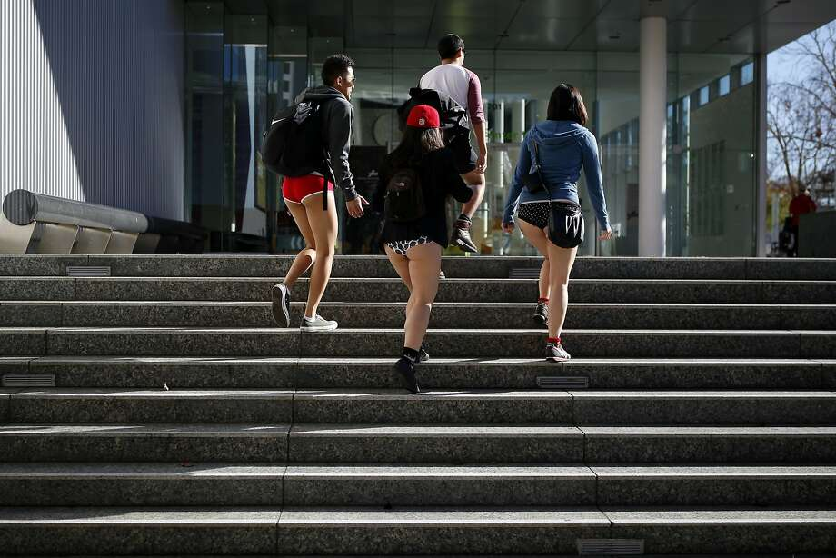 Participants in the annual No-Pants Subway Ride walk up steps at Yerba Buena Gardens after exiting at the Montgomery station in San Francisco, CA, Sunday, January 12, 2014. Photo: Michael Short, The Chronicle