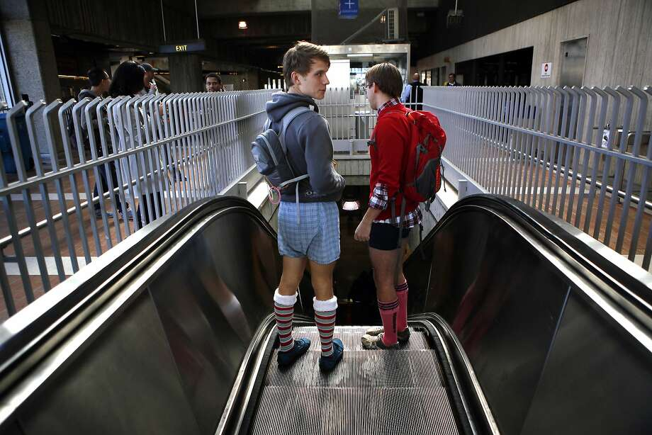 Nick Anastas, left, and Nigel Ray take the escalator down to the platform at the Balboa BART station during the annual No-Pants Subway Ride in San Francisco, CA, Sunday, January 12, 2014. Photo: Michael Short, The Chronicle