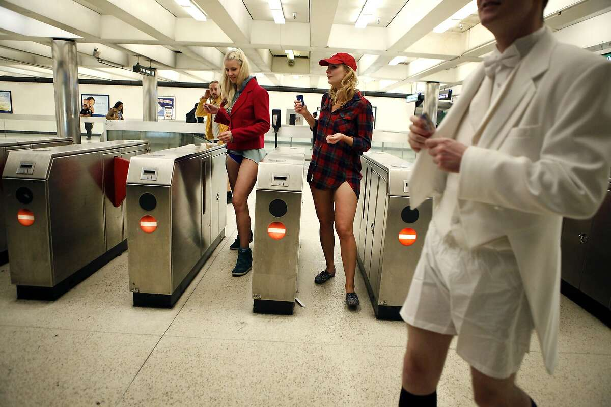 Nelly Grivko, left, from Moscow, Russia and her friend Alena Kruchkova of San Francisco, exit the Montgomery BART station during the annual No-Pants Subway Ride in San Francisco, CA, Sunday, January 12, 2014.