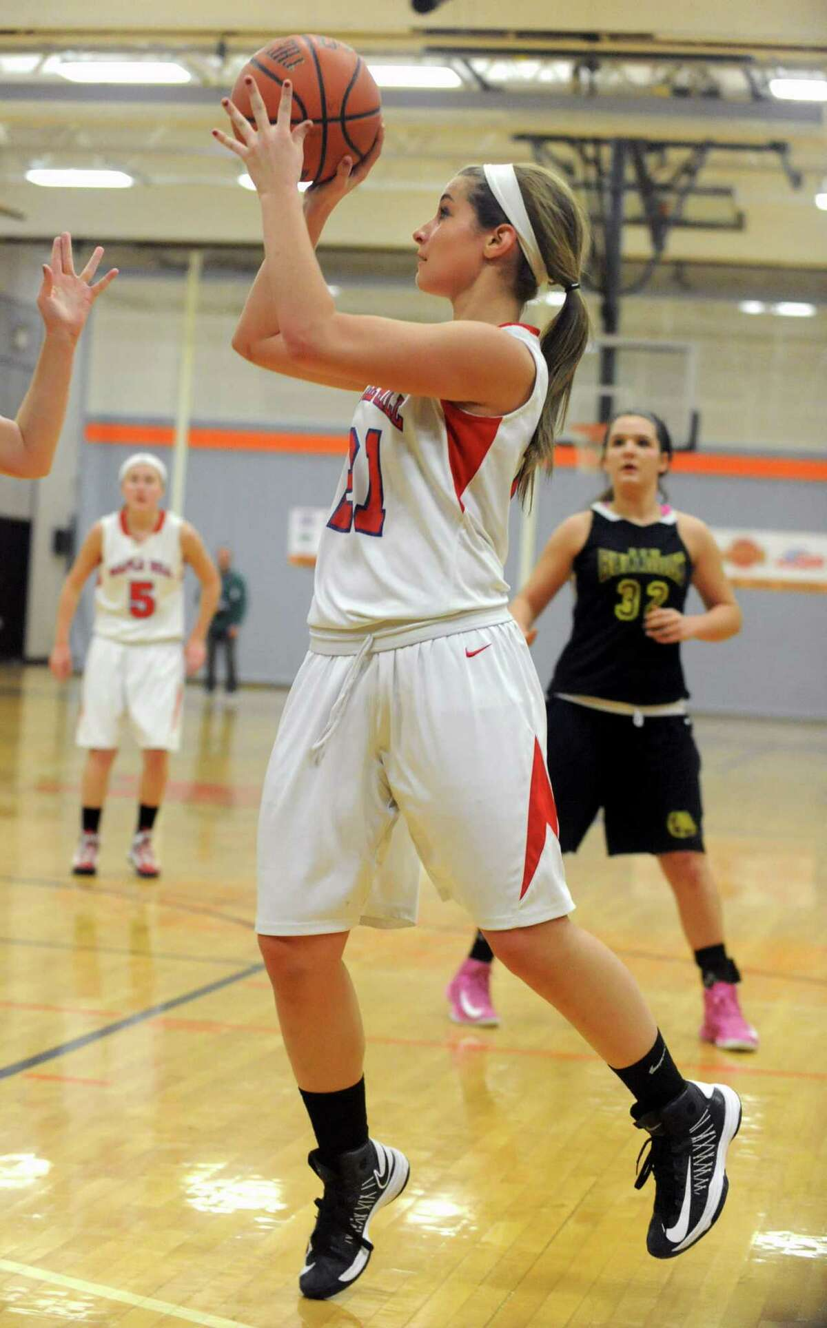 Maple Hills' Bella Nelson goes up for a jump shot during a basketball game against Berne Knox at Mohonasen High School on Friday Dec. 28, 2012 in Albany, N.Y. (Lori Van Buren / Times Union)