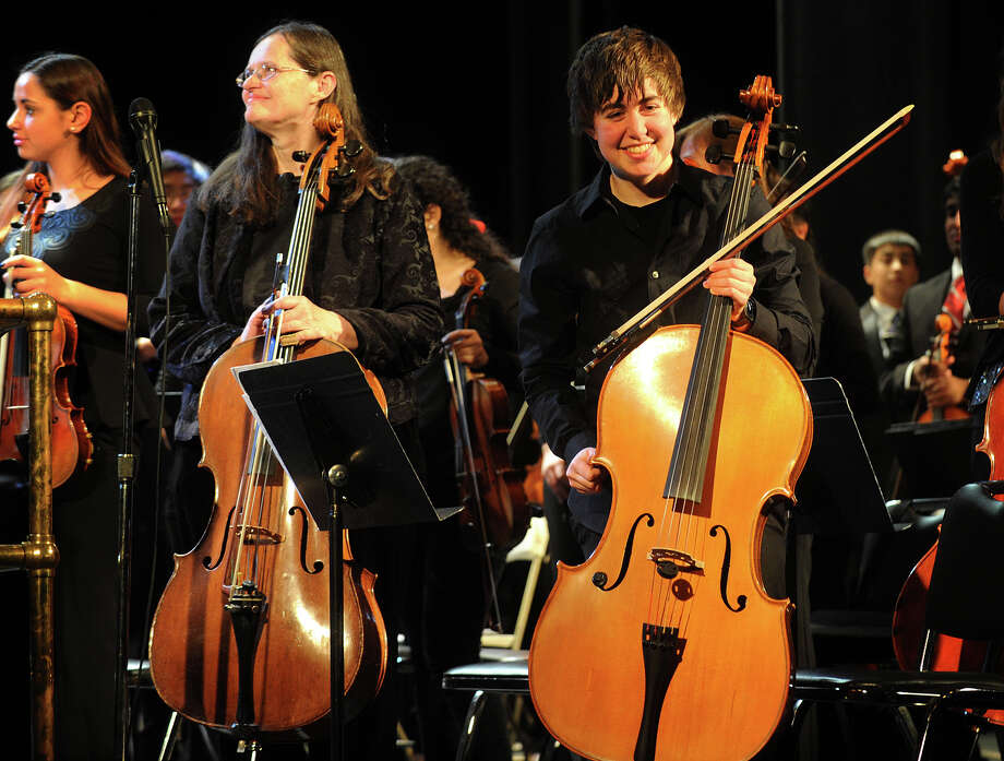 Greater Bridgeport Youth Orchestra cellist Amanda Mezoff, right, of Westport, smiles toward the audience after performing side by side with Greater Bridgeport Symphony cellist Darilyn Manring, of Bizet's Farandole from L'Arlesienne, Suite 2 at the Klein Memorial Auditorium in Bridgeport, Conn. on Sunday, January 12, 2014. Photo: Brian A. Pounds / Connecticut Post