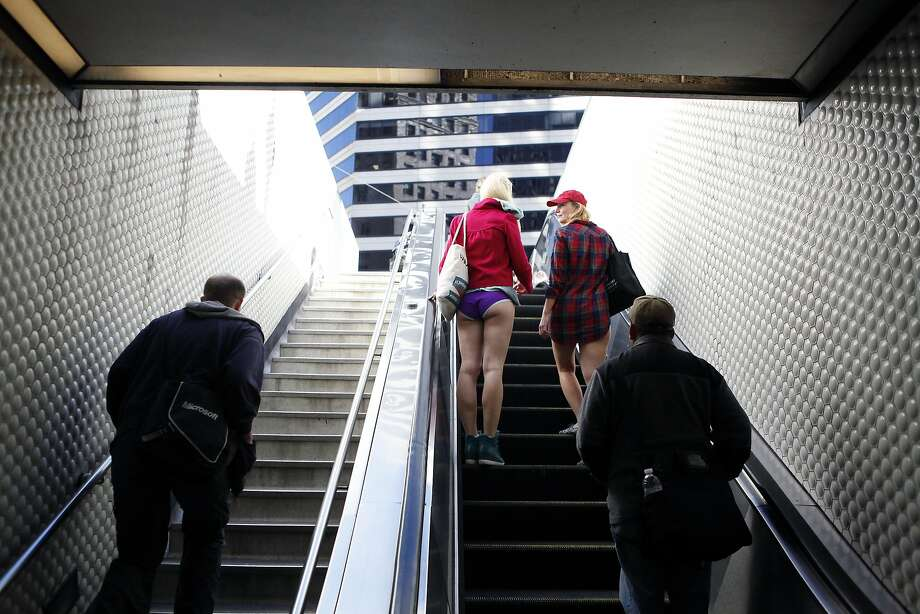 Nelly Grivko, left, from Moscow, Russia and her friend Alena Kruchkova of San Francisco, exit the Montgomery BART station during the annual No-Pants Subway Ride in San Francisco, CA, Sunday, January 12, 2014. Photo: Michael Short, The Chronicle