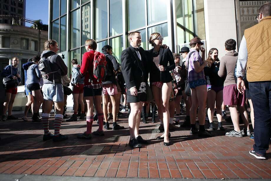 Participants in the annual No-Pants Subway Ride gather on Market St. after exiting at the Montgomery station in San Francisco, CA, Sunday, January 12, 2014. Photo: Michael Short, The Chronicle