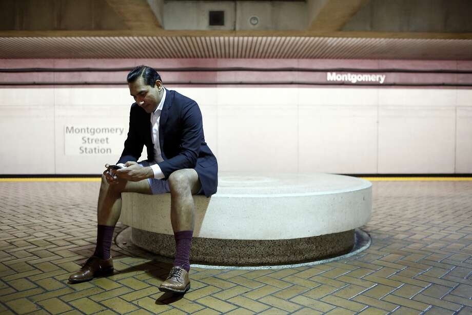 Pratyush Tiwari of San Francisco sits on a bench at the Montgomery BART station while participating in the annual No-Pants Subway Ride in San Francisco, CA, Sunday, January 12, 2014. Photo: Michael Short, The Chronicle