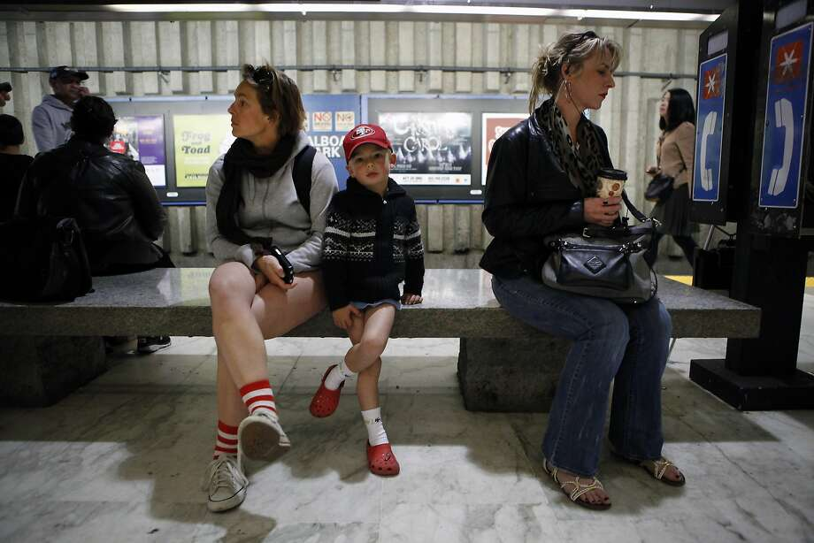 (no last names given)Lise and her 4 year old son son Victor wait at the Balboa BART station during the annual No-Pants Subway Ride in San Francisco, CA, Sunday, January 12, 2014. Photo: Michael Short, The Chronicle