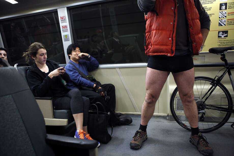 A BART passenger laughs at Daryl Munton, right, as participates in the annual No-Pants Subway Ride in San Francisco, CA, Sunday, January 12, 2014. Photo: Michael Short, The Chronicle