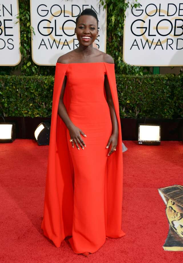 Lupita Nyong'o arrives at the 71st annual Golden Globe Awards at the Beverly Hilton Hotel on Sunday, Jan. 12, 2014, in Beverly Hills, Calif. Photo: Jordan Strauss, Associated Press