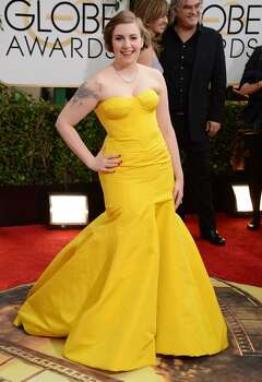 Lena Dunham arrives at the 71st annual Golden Globe Awards at the Beverly Hilton Hotel on Sunday, Jan. 12, 2014, in Beverly Hills, Calif. Photo: Jordan Strauss, Associated Press