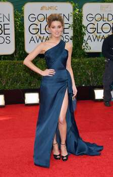Amber Heard arrives at the 71st annual Golden Globe Awards at the Beverly Hilton Hotel on Sunday, Jan. 12, 2014, in Beverly Hills, Calif. Photo: John Shearer, Associated Press
