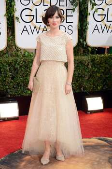 Zooey Deschanel arrives at the 71st annual Golden Globe Awards at the Beverly Hilton Hotel on Sunday, Jan. 12, 2014, in Beverly Hills, Calif. Photo: Jordan Strauss, Associated Press