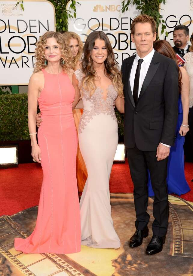 (L-R) Actress Kyra Sedgwick, Miss Golden Globe Sosie Bacon, and actor Kevin Bacon attend the 71st Annual Golden Globe Awards held at The Beverly Hilton Hotel on January 12, 2014 in Beverly Hills, California. Photo: Jason Merritt, Getty Images