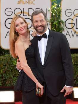 Leslie Mann, left, and Judd Apatow arrive at the 71st annual Golden Globe Awards at the Beverly Hilton Hotel on Sunday, Jan. 12, 2014, in Beverly Hills, Calif. Photo: John Shearer, Associated Press