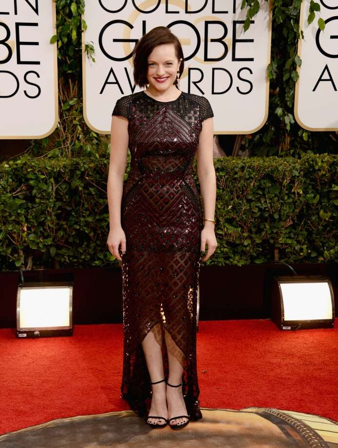 Actress Elisabeth Moss attends the 71st Annual Golden Globe Awards held at The Beverly Hilton Hotel on January 12, 2014 in Beverly Hills, California. Photo: Jason Merritt, Getty Images
