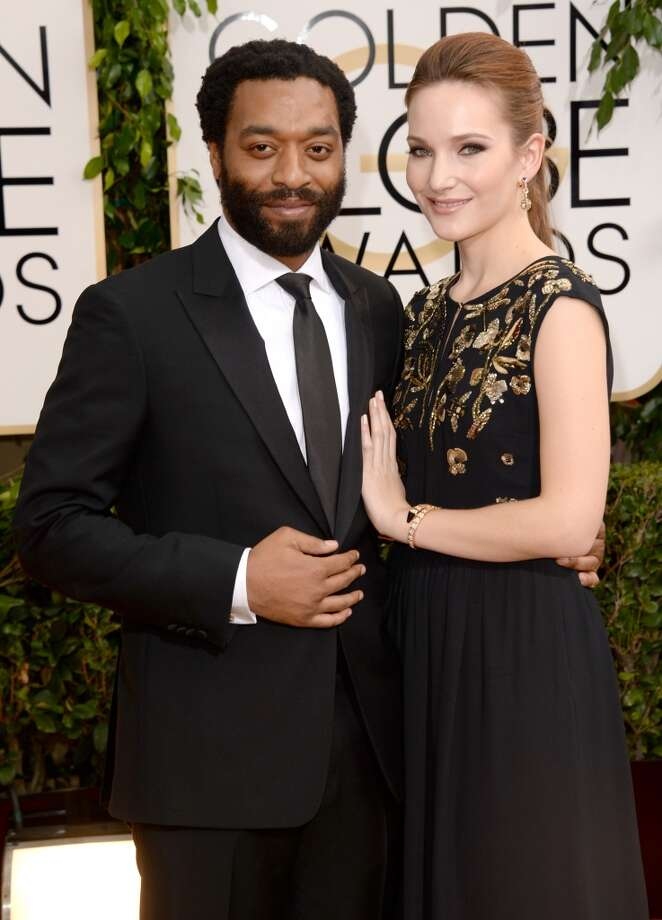 Actor Chiwetel Ejiofor (L) and Sari Mercer attend the 71st Annual Golden Globe Awards held at The Beverly Hilton Hotel on January 12, 2014 in Beverly Hills, California. Photo: Jason Merritt, Getty Images
