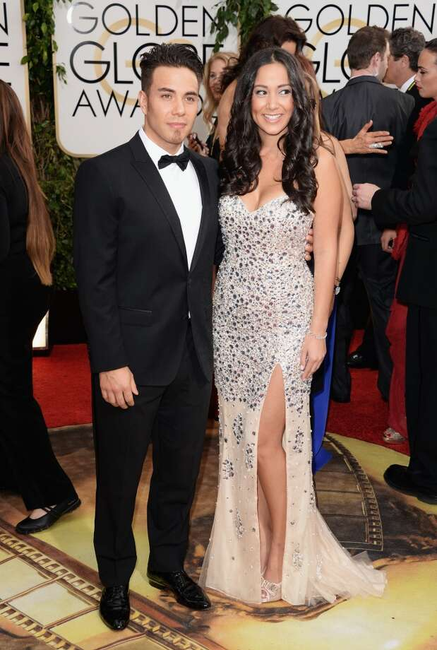 Olympic skater Apolo Ohno (L) and guest attend the 71st Annual Golden Globe Awards held at The Beverly Hilton Hotel on January 12, 2014 in Beverly Hills, California. Photo: Jason Merritt, Getty Images