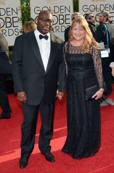 Steve McQueen, left, and Bianca Stigter arrive at the 71st annual Golden Globe Awards at the Beverly Hilton Hotel on Sunday, Jan. 12, 2014, in Beverly Hills, Calif. Photo: John Shearer, Associated Press