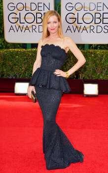 Leslie Mann arrives at the 71st annual Golden Globe Awards at the Beverly Hilton Hotel on Sunday, Jan. 12, 2014, in Beverly Hills, Calif. Photo: John Shearer, Associated Press