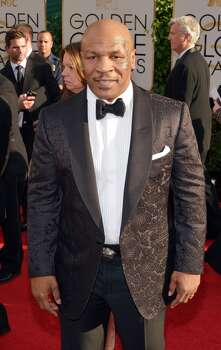 Mike Tyson arrives at the 71st annual Golden Globe Awards at the Beverly Hilton Hotel on Sunday, Jan. 12, 2014, in Beverly Hills, Calif. Photo: John Shearer, Associated Press
