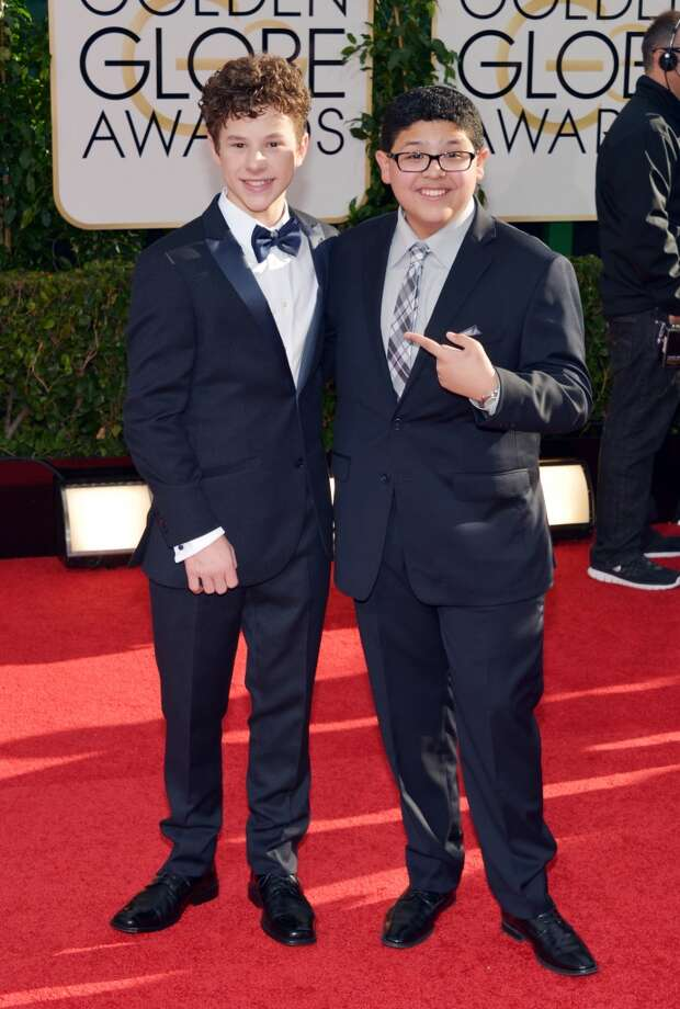 Nolan Gould, left, and Rico Rodriguez arrive at the 71st annual Golden Globe Awards at the Beverly Hilton Hotel on Sunday, Jan. 12, 2014, in Beverly Hills, Calif. Photo: John Shearer, Associated Press