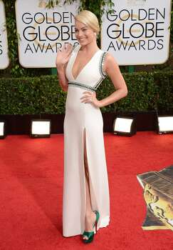 Margot Robbie arrives at the 71st annual Golden Globe Awards at the Beverly Hilton Hotel on Sunday, Jan. 12, 2014, in Beverly Hills, Calif. Photo: Jordan Strauss, Associated Press