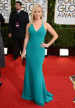 Reese Witherspoon arrives at the 71st annual Golden Globe Awards at the Beverly Hilton Hotel on Sunday, Jan. 12, 2014, in Beverly Hills, Calif. Photo: Jordan Strauss, Associated Press