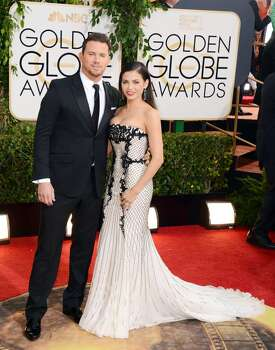 Channing Tatum, left, and Jenna Dewan arrive at the 71st annual Golden Globe Awards at the Beverly Hilton Hotel on Sunday, Jan. 12, 2014, in Beverly Hills, Calif. Photo: Jordan Strauss, Associated Press