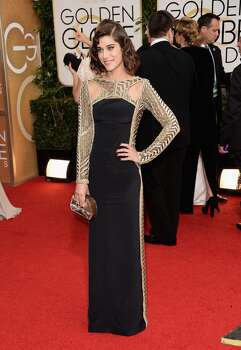 Actress Lizzy Caplan attends the 71st Annual Golden Globe Awards held at The Beverly Hilton Hotel on January 12, 2014 in Beverly Hills, California. Photo: Jason Merritt, Getty Images
