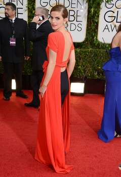 Emma Watson arrives at the 71st annual Golden Globe Awards at the Beverly Hilton Hotel on Sunday, Jan. 12, 2014, in Beverly Hills, Calif. Photo: Jordan Strauss, Associated Press