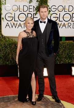 Actor Chris Hemsworth (R) and wife Elsa Pataky attend the 71st Annual Golden Globe Awards held at The Beverly Hilton Hotel on January 12, 2014 in Beverly Hills, California.  (Photo by Jason Merritt/Getty Images) Photo: Jason Merritt, Getty Images