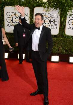 Jimmy Fallon arrives at the 71st annual Golden Globe Awards at the Beverly Hilton Hotel on Sunday, Jan. 12, 2014, in Beverly Hills, Calif. Photo: Jordan Strauss, Associated Press