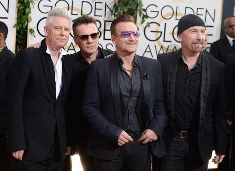Members of the Irish rock band U2, from left, Adam Clayton, Larry Mullen, Jr., Bono, and The Edge arrive at the 71st annual Golden Globe Awards at the Beverly Hilton Hotel on Sunday, Jan. 12, 2014, in Beverly Hills, Calif. Photo: Jordan Strauss, Associated Press