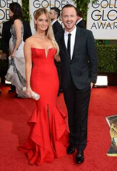 Lauren Parsekian, left, and Aaron Paul arrive at the 71st annual Golden Globe Awards at the Beverly Hilton Hotel on Sunday, Jan. 12, 2014, in Beverly Hills, Calif. Photo: Jordan Strauss, Associated Press