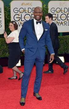 Terry Crews arrives at the 71st annual Golden Globe Awards at the Beverly Hilton Hotel on Sunday, Jan. 12, 2014, in Beverly Hills, Calif. Photo: John Shearer, Associated Press