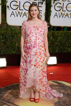 Drew Barrymore arrives at the 71st annual Golden Globe Awards at the Beverly Hilton Hotel on Sunday, Jan. 12, 2014, in Beverly Hills, Calif. Photo: Jordan Strauss, Associated Press