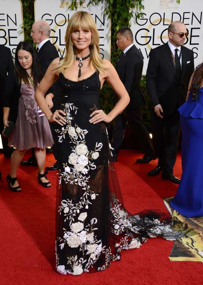 Heidi Klum arrives at the 71st annual Golden Globe Awards at the Beverly Hilton Hotel on Sunday, Jan. 12, 2014, in Beverly Hills, Calif. Photo: Jordan Strauss, Associated Press
