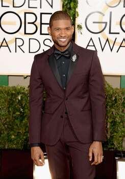 Singer Usher attends the 71st Annual Golden Globe Awards held at The Beverly Hilton Hotel on January 12, 2014 in Beverly Hills, California. Photo: Jason Merritt, Getty Images