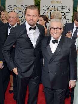 Leonardo DiCaprio, left, and Martin Scorsese arrive at the 71st annual Golden Globe Awards at the Beverly Hilton Hotel on Sunday, Jan. 12, 2014, in Beverly Hills, Calif. Photo: John Shearer, Associated Press
