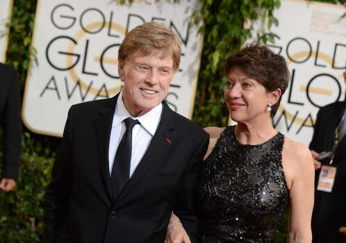 Robert Redford, left, and Sibylle Szaggars arrive at the 71st annual Golden Globe Awards at the Beverly Hilton Hotel on Sunday, Jan. 12, 2014, in Beverly Hills, Calif. (Photo by Jordan Strauss/Invision/AP) Photo: Jordan Strauss, Associated Press